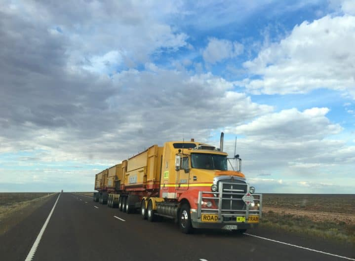 truck driving on an empty highway